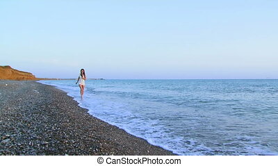 The girl runs to the sea - Semi-naked beautiful girl flees...