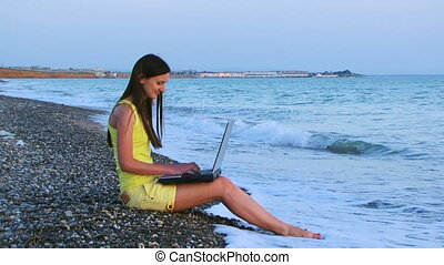 On the beach with a laptop