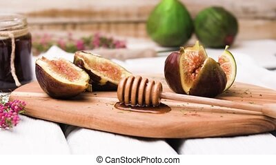 Figs and honey on a wooden table selective focus