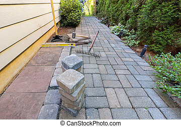 Stone Pavers and Tools for Side Yard Landscaping - Stone...