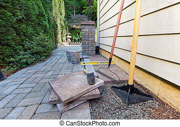 Stone Pavers and Tools for Side Yard House Landscaping -...
