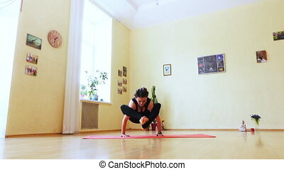 Girl is engaged in yoga - In room on floor girl doing yoga