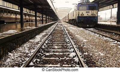 Railawy station in winter - Winter scene withlocomotive...