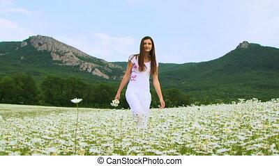 She walks across the field