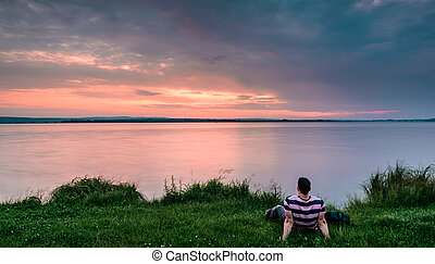Sunrise and man - Man sitting and looking to beautiful...