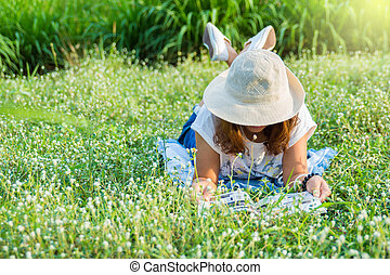 girl reading book in tha park. - girl reading book at the...
