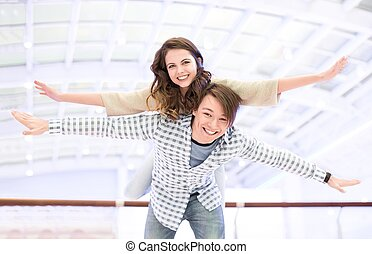 Young teenager - Happy young couple indoors