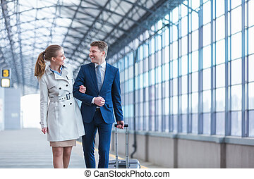 Traveling people - Young business people at station