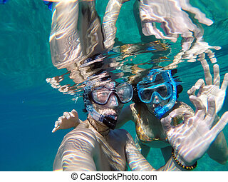 Young couple snorkeling in the honeymoon