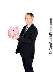 Businessman with big piggybank - Smiling mature businessman...