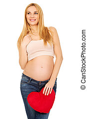 Pregnant woman with a heart pillow - Happy pregnant woman...