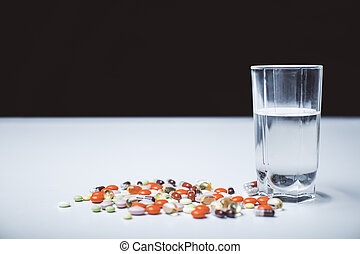 Tabletop with pills and water - Closeup of white tabletop...