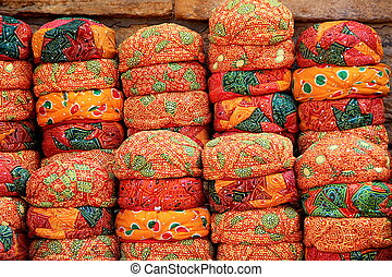 Stack of Red Rajasthani Caps - Display of neatly piled up...