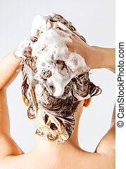 Woman taking a shower and shampooing her hair. Isolated on...