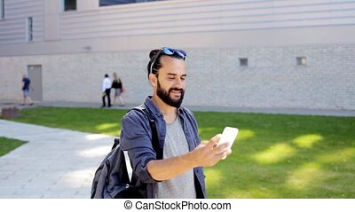 man taking video or selfie by smartphone in city 33 -...