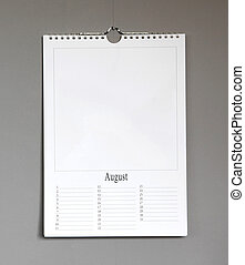 Simple old birthday calendar hanging on a grey wall - August...