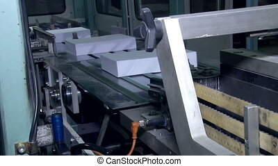 Bundles of paper cut on a conveyor belt 2 - Work shop for...