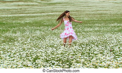Girl spins on the field