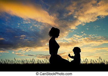 mother with son at sunset - illustration of mother with son...