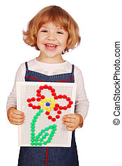 happy little girl with mosaic toy