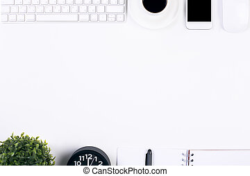 White desk with office items - Top view of white table with...