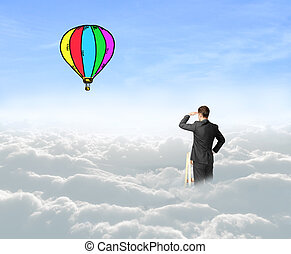 businessman on air baloon - businessman on cloud looking on...