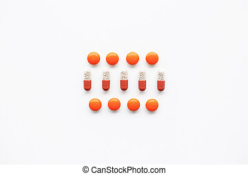 Rows of pills topview - Top view of red and orange pill and...