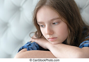 sad little girl at home - portrait of sad little girl at...