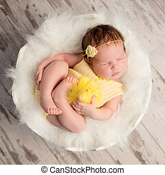 funny sleeping baby in yellow romper on round cot - funny...