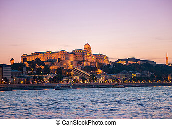Budapest Castle at sunset, view from Danube - illuminated...