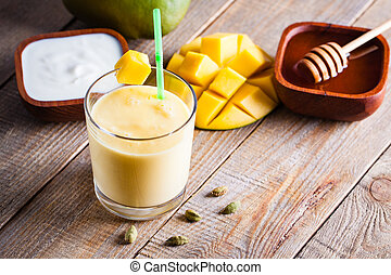 Glass of mango lassi Indian drink flavored with cardamom....