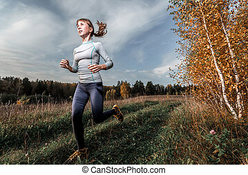 Woman in the forest - Woman in sportswear running along the...
