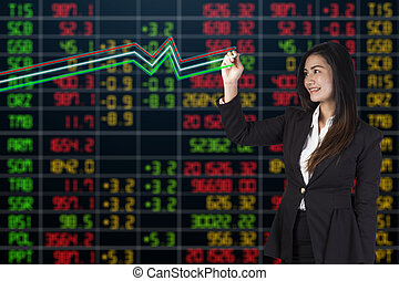 business woman standing with stock market background
