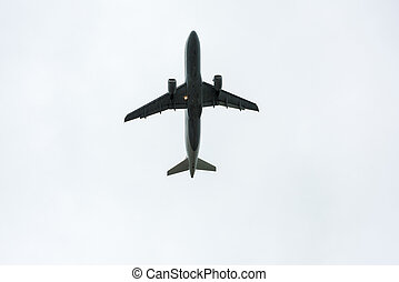 Airplane taking off during rain - Airplane taking off in a...