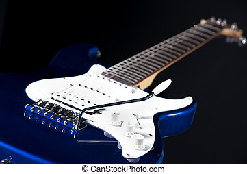 Blue Guitar Isolated On Black