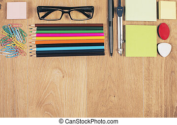 Desktop with stationery and glasses - Top view of wooden...