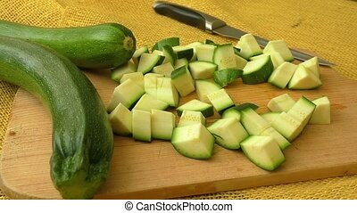 Sliced zucchini on a wooden cutting board