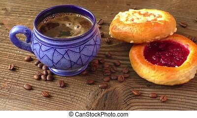 Sweet pastry with fruit jam served with hot coffee