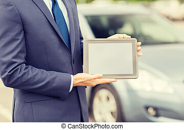 close up of young man with tablet pc and car - transport,...