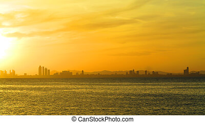 View of city and Sea at sunset
