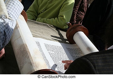 A Torah Scroll is Read From - An open Torah scroll is read...