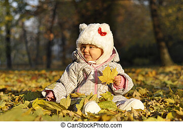 baby with leaves