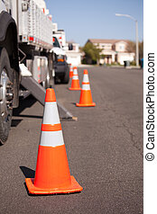 Orange Hazard Cones and Utility Truck in Street - Several...