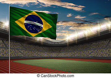 Track and field Stadium - Brazilian Flag in front of a Track...