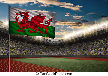 Track and field Stadium - Welsh Flag in front of a Track and...