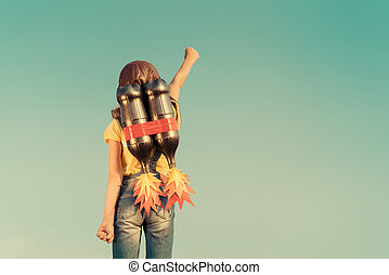 Kid playing with jet pack - Kid with jet pack pretend to be...