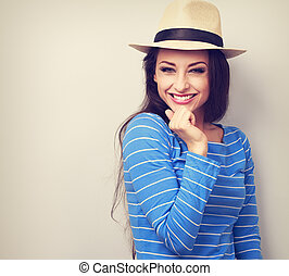 Beautiful long hair laughing woman in blue top and straw hat...