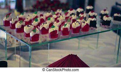 Candy bar. Table with sweet  candies. Wedding cake