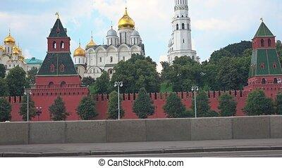 Sportsman running uphill against Moscow Kremlin 4K steadicam...