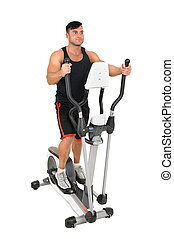 young man doing exercises on elliptical cross trainer -...